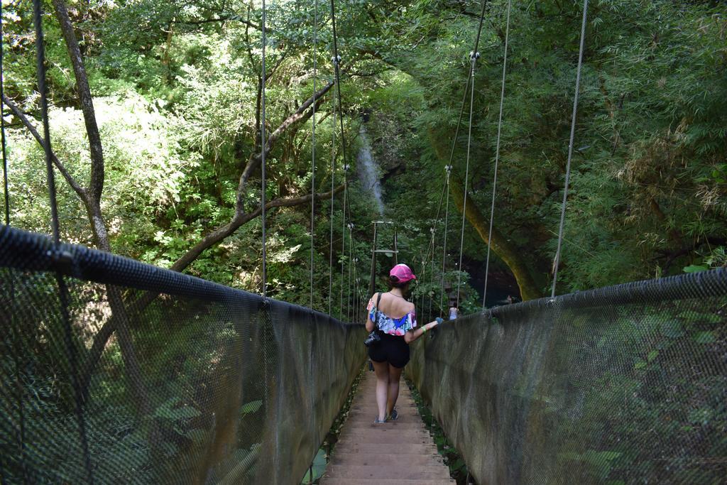 Walk across the bridge at Hacienda Guachipelin Volcano Ranch Hotel & Hot Springs.