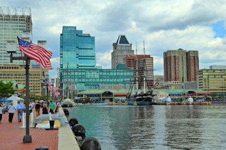 Baltimore, home of the Star Spangled Banner, with a busy harbor where you can often see the American Flag waving.