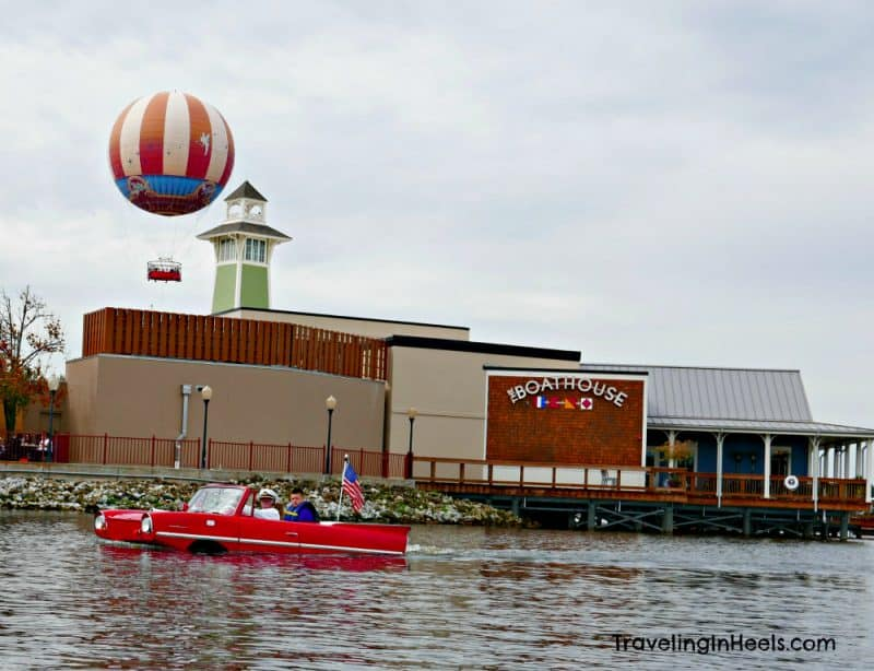Boathouse, an amphicar, and a balloon, 3 of 7 reasons to visit Disney Springs in Walt Disney World.