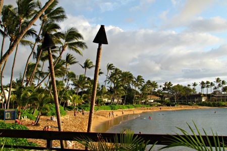 One of Hawaii's many relaxing beachs for mom includes Napili Kai Beach Resort in Maui.