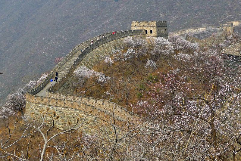 No educational travel adventure would be complete without a Journey along the Great Wall of China, an Ancient Wonder of the World - TravelingInHeels.com