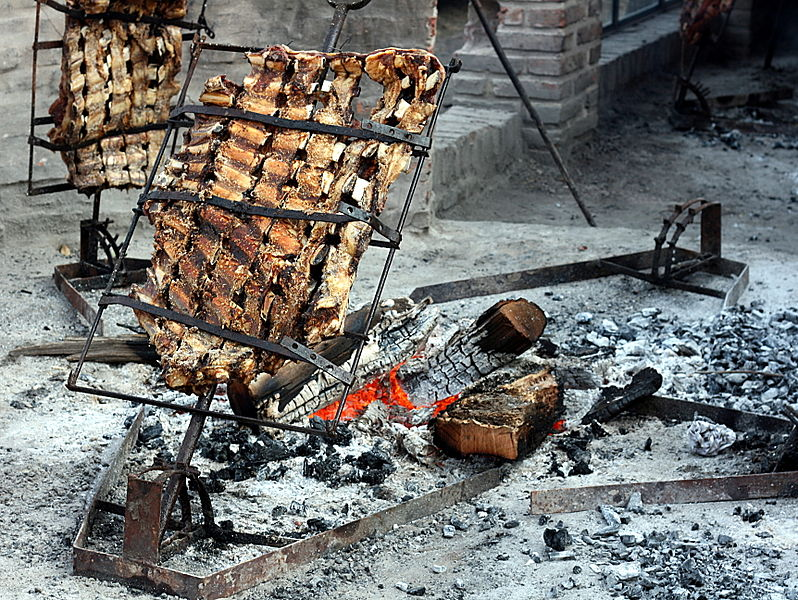 Preparing the famous meat asado, 1 of 10 things to do in Buenos Aires, Argentina. Photo credit: Flickr /luis-argerich