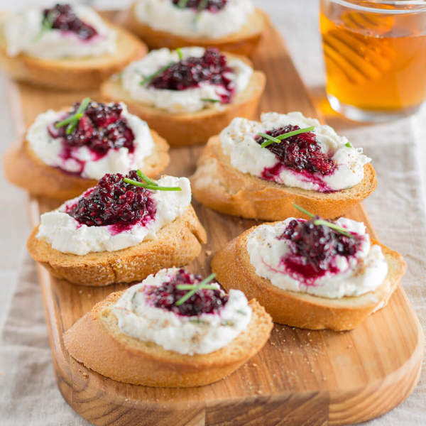 For the holidays, try this Buzzy Bruschetta, a 10-minute refreshingly simple, honey recipe. Photo Credit: National Honey Board