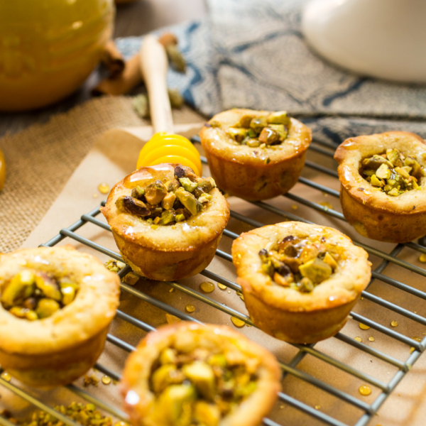 Perfect for cocktail parties as a pass-and-pick-up bite, this sweet crowd-pleasing Baklava Cookie Cups turns out two-dozen mini muffin-sized cookie cups in just 10 minutes. Photo credit: National Honey Board