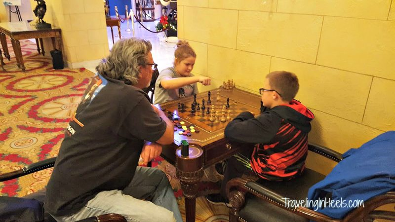 Gift Ideas for Grandparents Day include a play date when Grandpa teaches grandkids the game of chess.