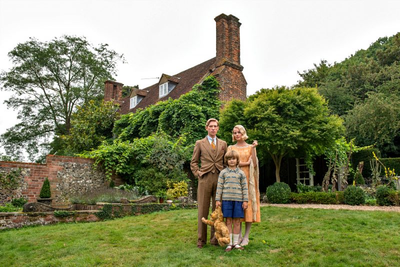 Domhnall Gleeson, Will Tilston and Margot Robbie in the film GOODBYE CHRISTOPHER ROBIN. Photo by David Appleby. © 2017 Twentieth Century Fox Film Corporation All Rights Reserved