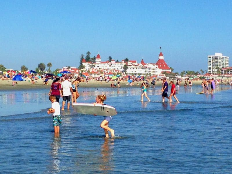 Empty nest travel tips include taking out a map and exploring different areas and hotels near your adult kids home, such as Hotel Del Coronado in California.