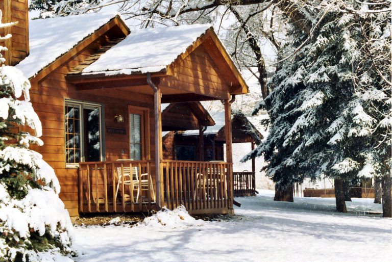 Cozy up in a romantic cabin for two at Sylvan Dale Guest Ranch, 1 of 3 romantic travel deals to Loveland, Colorado.