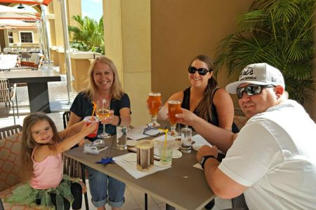 Dining al fresco on the balcony of Ravello near the Lobby Bar of Four Seasons Resort Orlando
