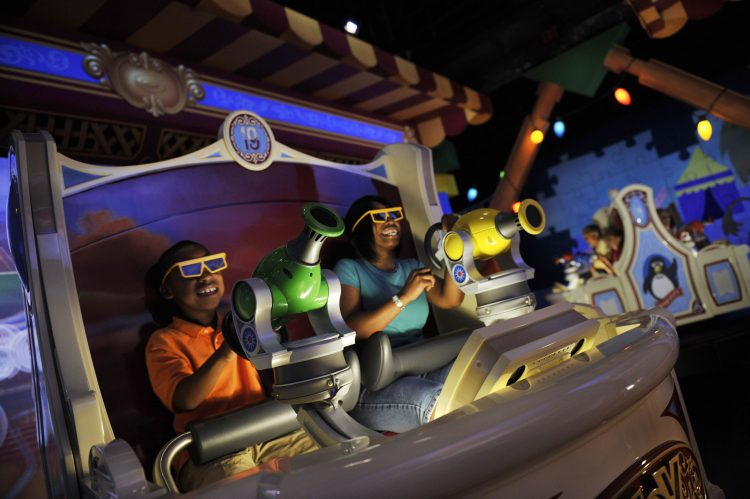 "4-D FUN FOR ALL: Donning 3-D glasses and manning ""spring-action shooters,"" Walt Disney World guests enjoy ""Toy Story Mania!"" attraction at Disney's Hollywood Studios in Lake Buena Vista, Fla. (Disney) (PRNewsfoto/Walt Disney World)"