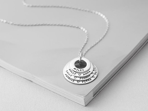 This beautiful hand-stamped grandmother necklace can hold up to 10-15 grandchildren's names. Photo credit: Etsy