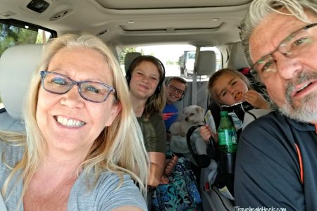 When road tripping with multigenerational family, consider renting a Chrysler Pacifica or other larger mini van or SUV with Tvs built in for entertainment and for more personal space.