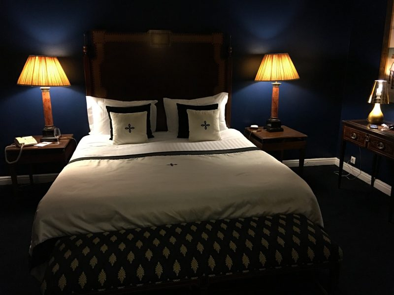 Choose your hotel room carefully, from mattresses to location to lighting, for a better night's sleep when traveling.