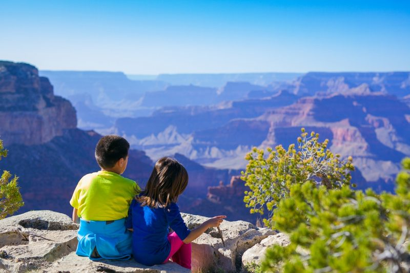 Teach your kids to love the outdoors with hikes when camping with family.