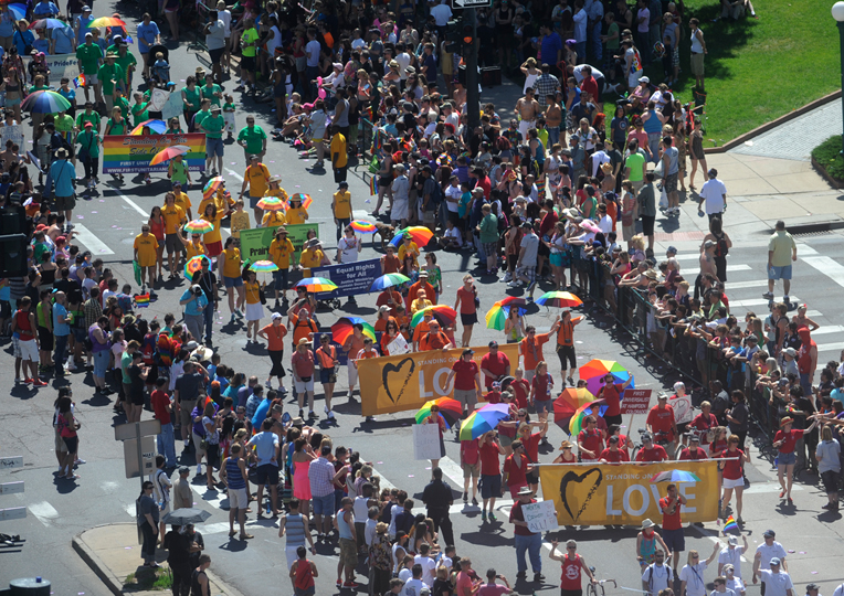 Participants and onlookers of the Denver Pridefest parade in downtown Denver. Photo credit: Evan Semon