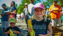Children eating corn on the cob during Taste of Colorado festival Photo credit: Evan Semon and VISIT DENVER