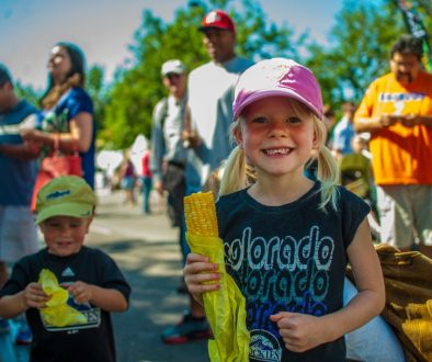 Children eating corn on the cob during Taste of Colorado festival Photo credit: Evan Semon and VISIT DENVER