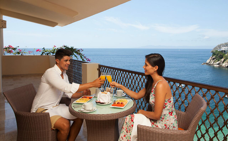 Cheers to ocean views from our balcony. Photo credit: Barcelo Puerto Vallarta