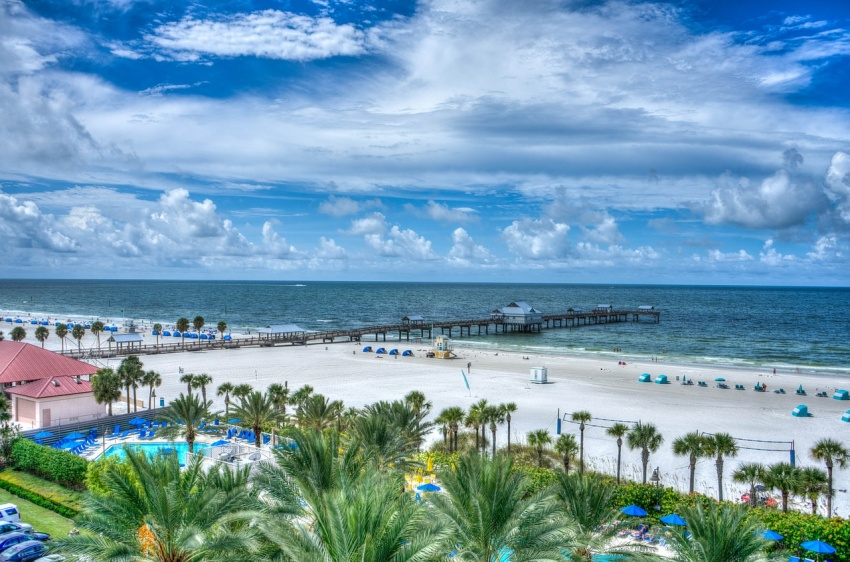 Clearwater Beach is known for its namesake stretch of soft, white sand, which draws visitors year-round for jet-skiing, parasailing, and stand-up paddleboarding in its calm waters.