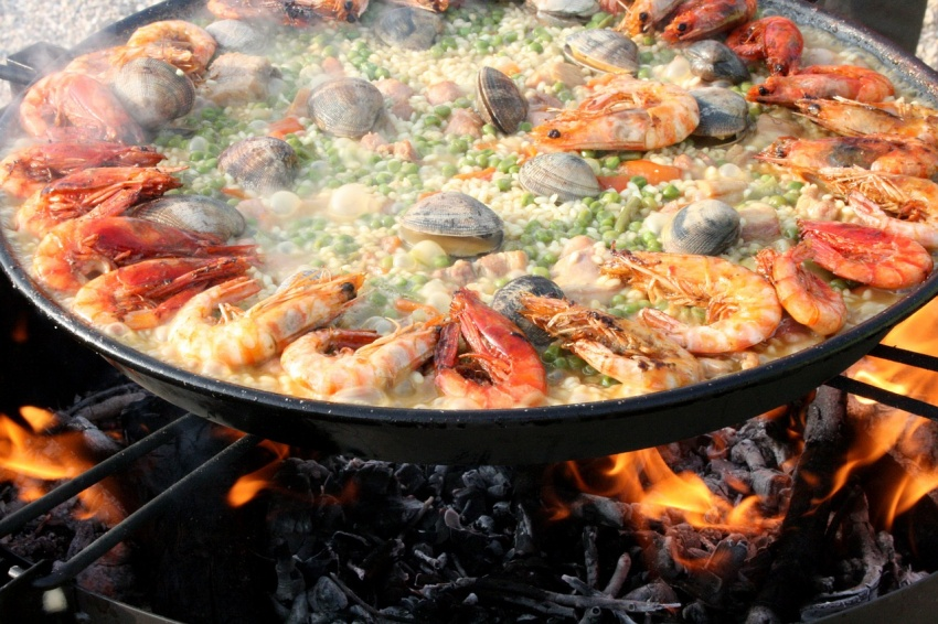Local and authentic Spanish food is worth the visit, like paella, a dish from Valencia, Spain