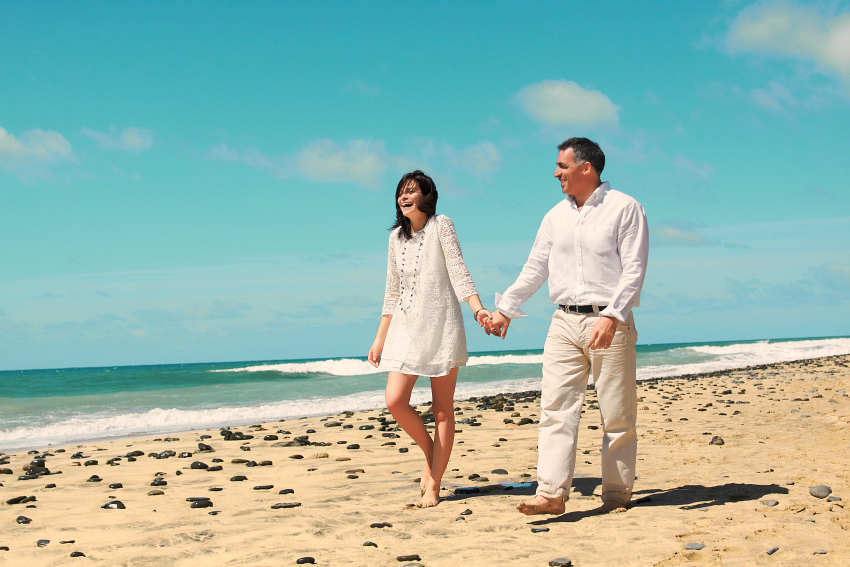 With these tips for adventure travel over 50, go parasailing first and then take a leisurely walk on the beach.
