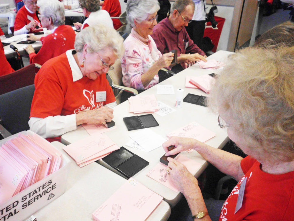 Volunteers from Loveland, the Sweetheart City in Colorado, pen special messages. P