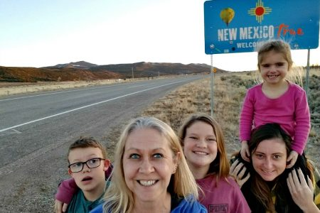 Family road trip tips include stopping to take photos of all the state line signs.
