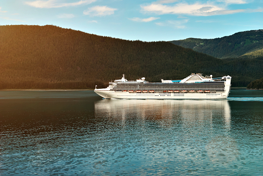Cruise ship in Alaskan landscape. Vacation on big boat travel between fjords