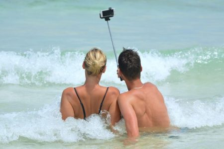 Read on for tips to better travel selfies.