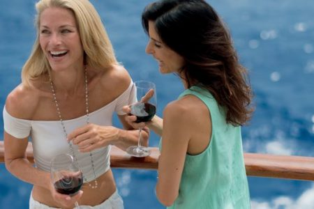 Paul Gauguin cruises offer women the opportunity to enjoy wine with their friends.