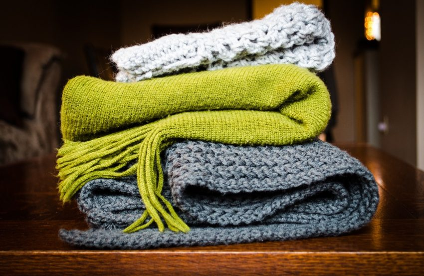 Invest in a blanket scarf to use on the plane to keep you warm, and a fashionable accessorize when you travel.