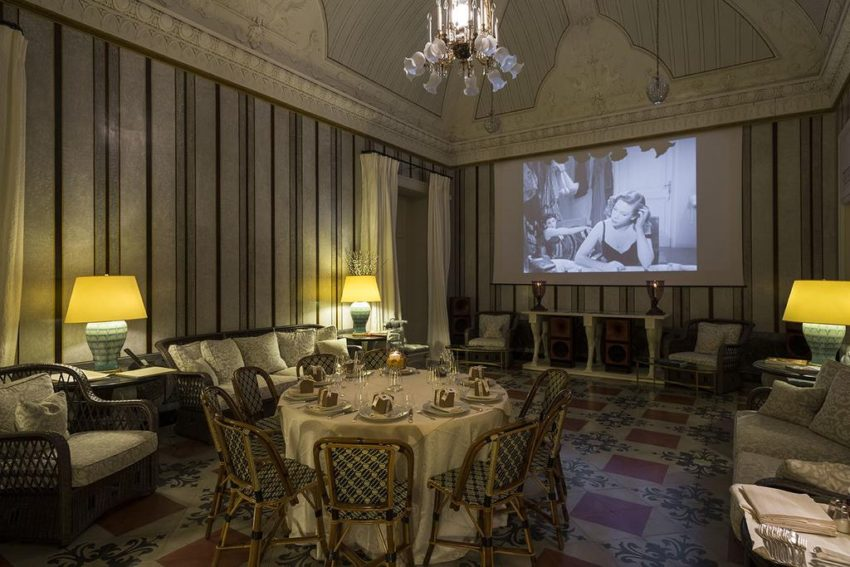 Watch an old movie in this elegant hotel dining room at Palazzo Margherita, Italy.