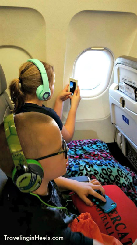 When traveling with kids, keep entertained with headphones and/or wireless earpods, downloadable games or audible books.