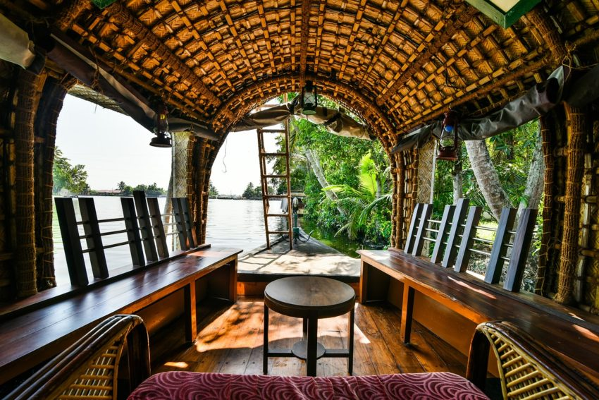 Rent a houseboat and cruise the backwaters of Kerala, India.