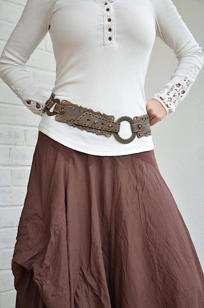 A wide leather hip belt is the perfect accessory for a blouse and skirt with cowboy boots. Photo: Etsy
