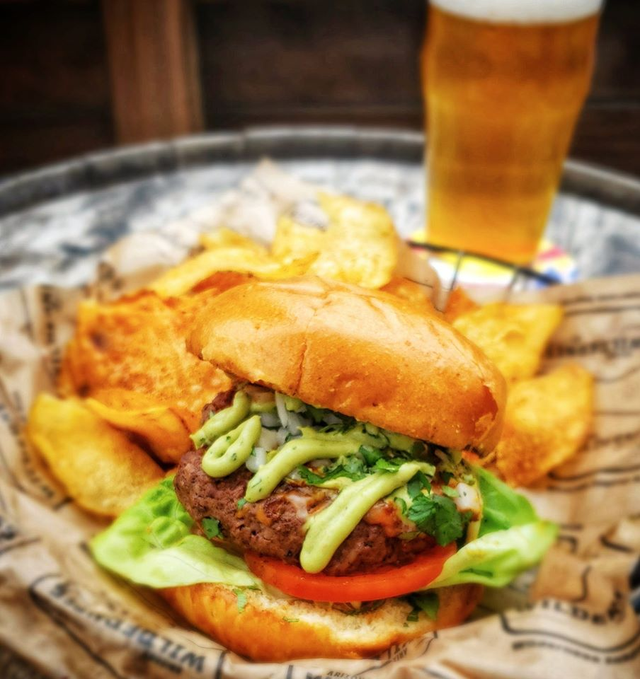 Stop in at Arizona Wilderness Brewing Co in Gilbert, serving locally sourced food including this Enchilada Burger. Photo credit: Arizona Wilderness Brewing Facebook page