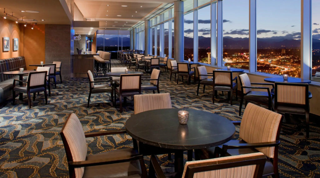One of the most romantic things to do in Denver is sip a cocktail and enjoy the view at Peaks Lounge on the 27th floor of the Hyatt Regency Denver at the Colorado Convention Center.