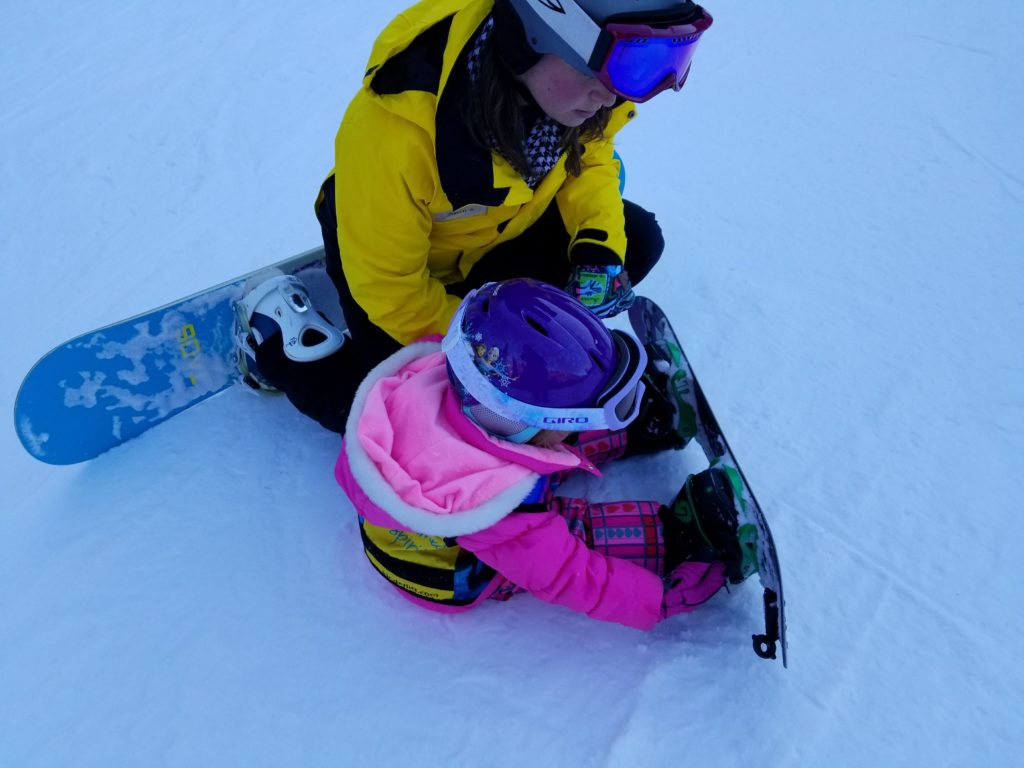 Kids as young as three can take snowboarding lessons at Taos, New Mexico.