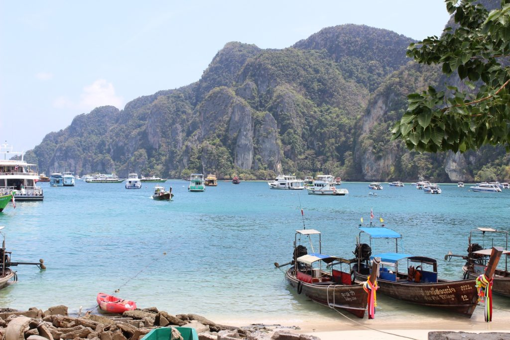 Stunning beaches and friendly people, visiting Phuket, Thailand makes the list of best vacations for empty nesters.
