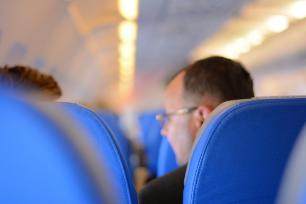For healthy eyes when traveling, wear your glasses and avoid wearing contact lenses.