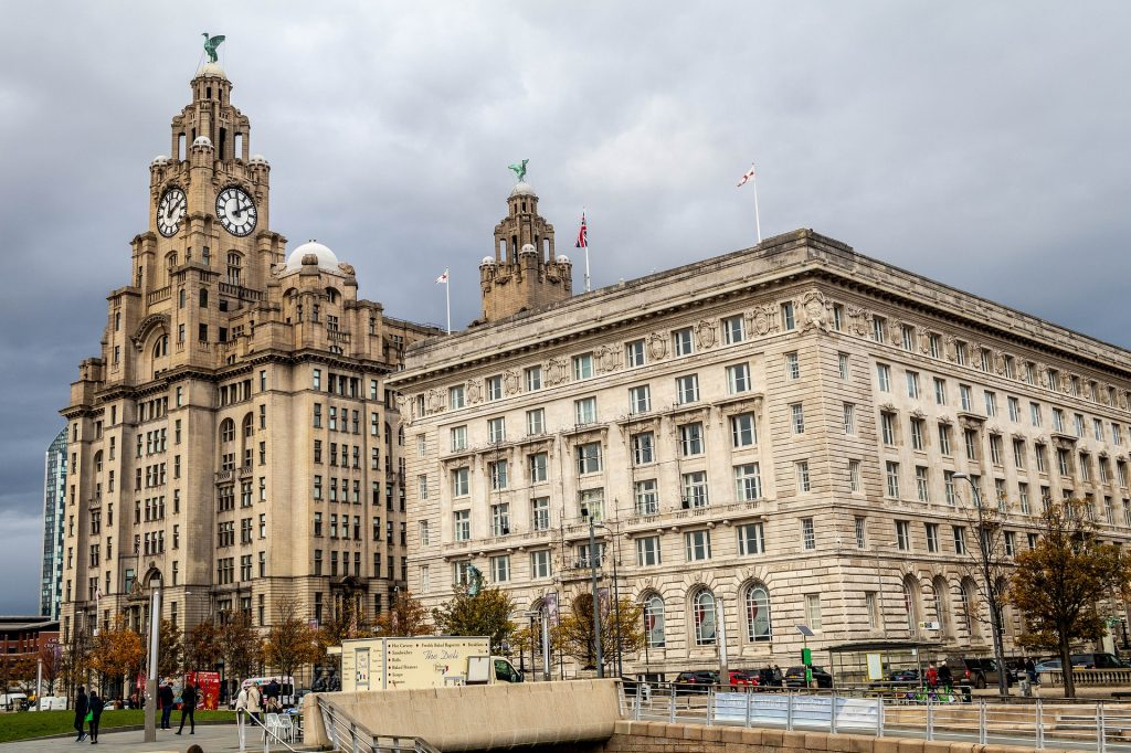 "waterfront, where the iconic mercantile buildings known as the ""Three Graces"" – Royal Liver Building, Cunard Building and Port of Liverpool Building – stand on the Pier Head."