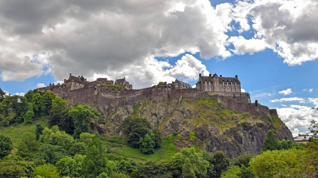 Dominating the Scottish skyline is the Edinburgh Castle, a historic fortress.
