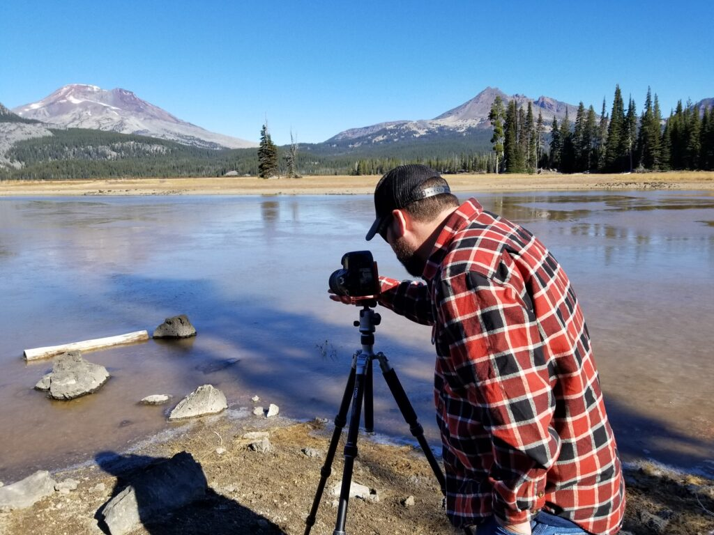 My son-in-law setting up his DSLR camera to take photos of a lake near Bend, Oregon.