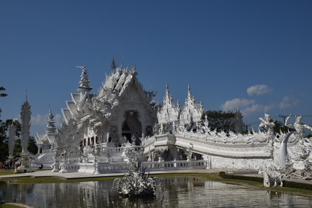 Wat Rong Khun, perhaps better known to foreigners as the White Temple, is a privately owned art exhibit in the style of a Buddhist temple in Chiang Rai Province, Thailand.