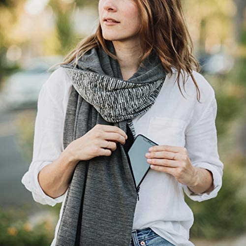 This travel scarf also features hidden pockets.