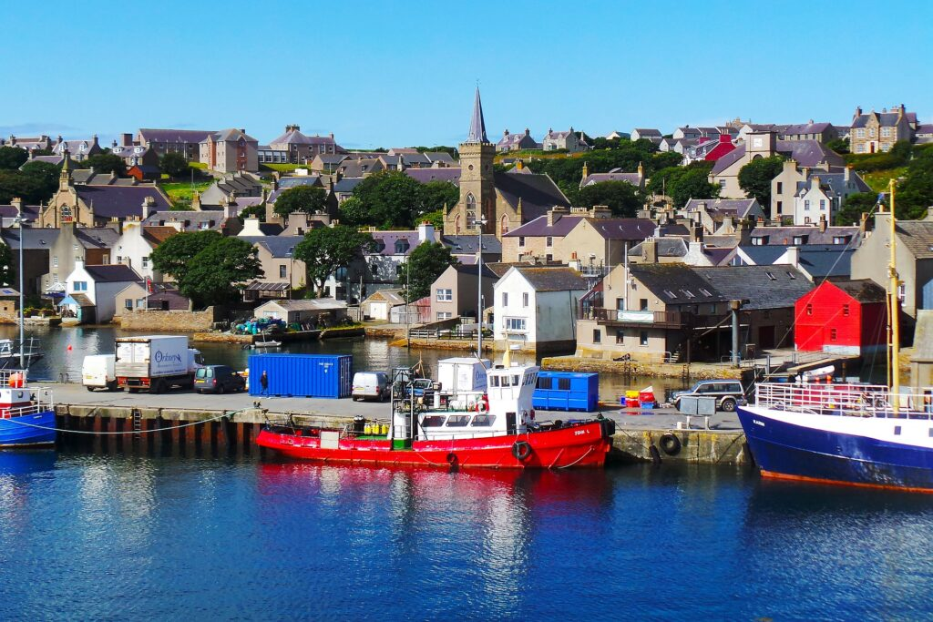 The jewel of fishing destinations, these colorful fishing vessels are in Orkney Islands in Scotland.