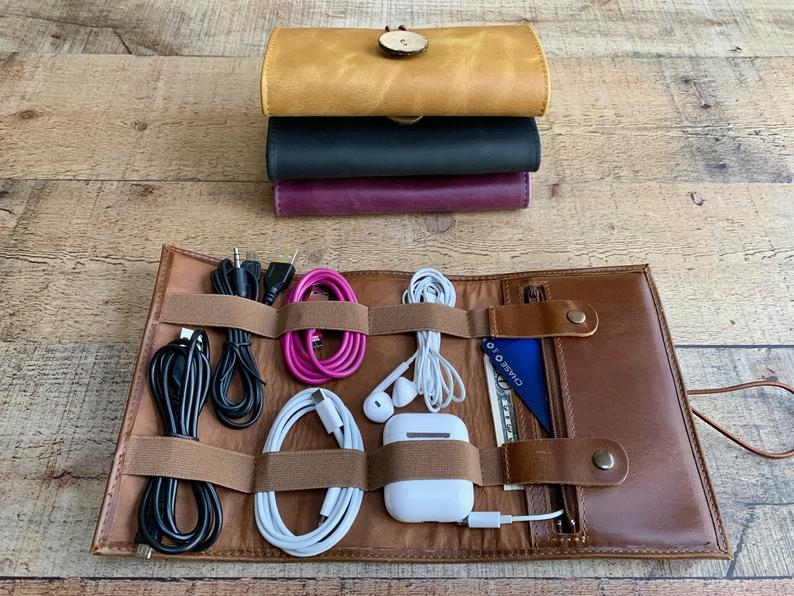 Handmade leather cable travel to keep all of your accessories together, from chargers to credit cards. Photo: Etsy/MisterCrafter