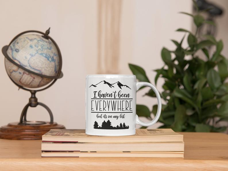The gift of travel is best served in a travel-themed coffee mug. Photo: Etsy