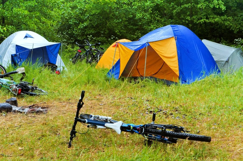 Dress in layers and bring your rain gear on your family camping trip.
