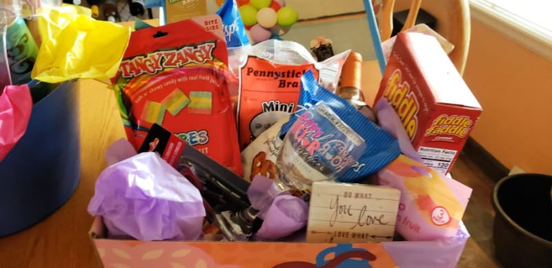 Put together an inexpensive care package at Dollar Tree